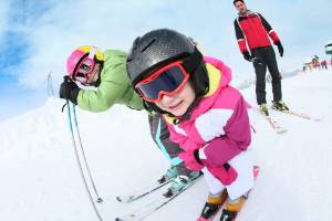 Save the pro gear until you know kids can ski and want to do it again.