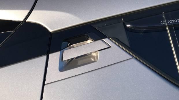 Hidden rear doorhandles give C-HR a coupe-like look.