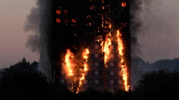 Britons cry for London fire victims as death toll rises to 79