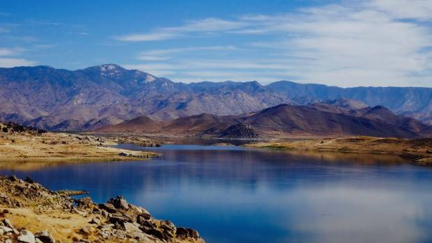 Death Valley in Eastern California, USA after a night of heavy rain. Shallow lakes had formed (a very rare event) giving ...
