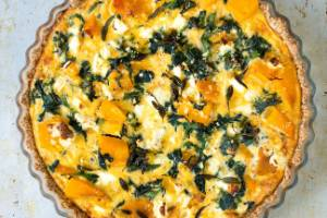Pumpkin, spinach and feta tart with oat and almond crust.