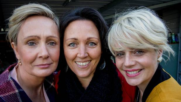 Lisa Torres, centre, will benefit from a charity auction organised by friends Megan Gowan, left, and Jodie Woods, right.