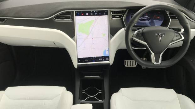 Dashboard identical to the Model X sedan, including Tesla's signature 17-inch touch-screen.