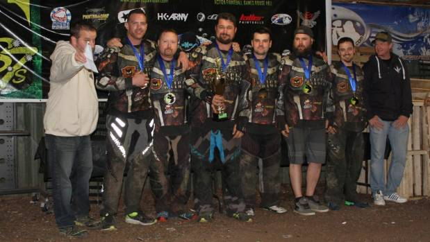 Two officials flank the winning Immortal Knights paintball team, from left: Troy O'Donnell, Alan Guest, Gene (the Hoff) ...