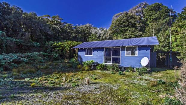 One of New Zealand's oldest and most remote holiday homes in Fiordland National Park is being put up for sale.