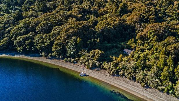 The three-bedroom property, inland from Martins Bay, is accessible by boat, air or on foot using the nearby Hollyford Track.