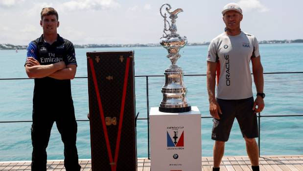 Rival helmsmen Peter Burling and Jimmy Spithill with the prize on offer in Bermuda