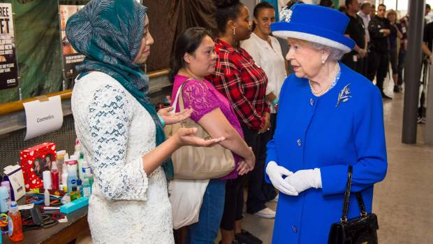 Queen Elizabeth II meets members of the community affected by the fire at Grenfell Tower in west London during a visit ...