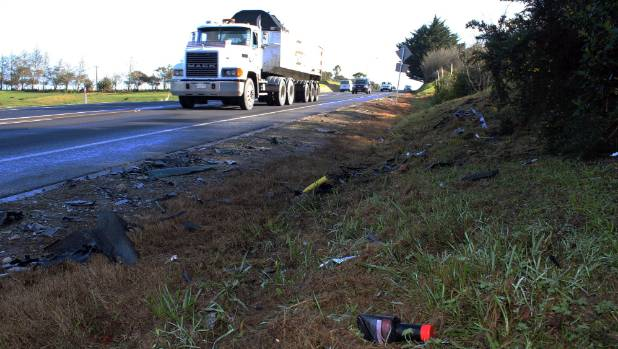 Debris from the crash litters the stretch of highway between Jeffs and Green roads.