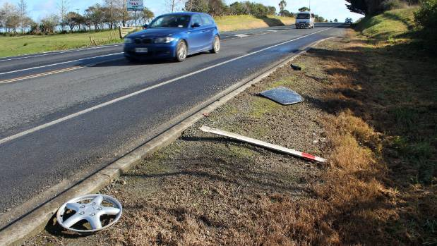 Parts of the cars including a hub cap and window remain on the road side.
