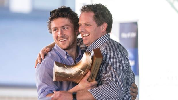 Winner of the 2016 Rural Bachelor title, Paul Olsen, right, hands over the trophy to the 2017 Rural Bachelor of the Year ...