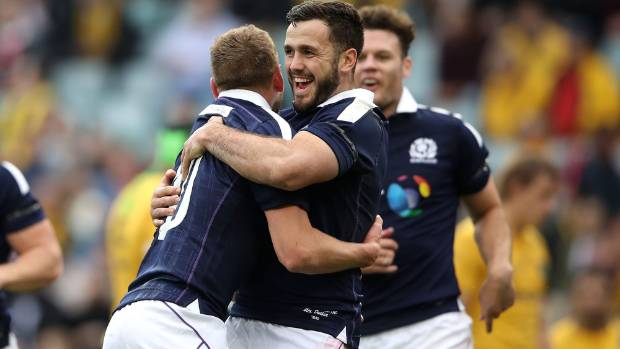 Finn Russell of Scotland celebrates after scoring a try against Australia on Saturday.