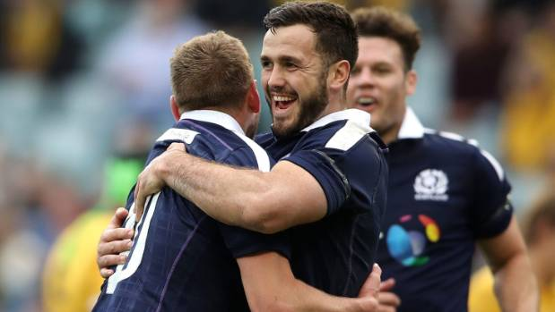 Scotland's Finn Russell celebrates with his team mate Alex Dunbar after scoring a try against Australia.