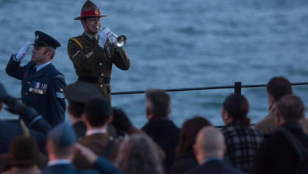 Australians and New Zealanders listen as the last post is played during the Dawn Service at Gallipoli in 2016.