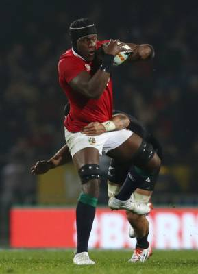 Maro Itoje of the Lions is tackled by Liam Messam.