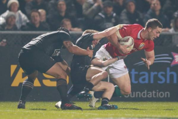George North of the Lions gets away.