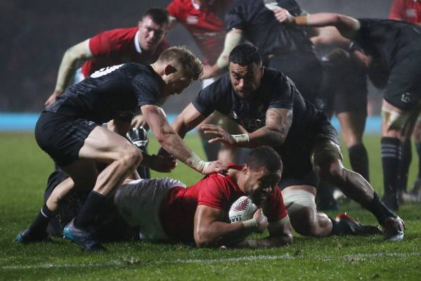 Taulupe Faletau of the Lions is hauled down short of the tryline.