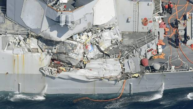 The damage of the right side of the USS Fitzgerald after the Navy destroyer collided with a container ship.