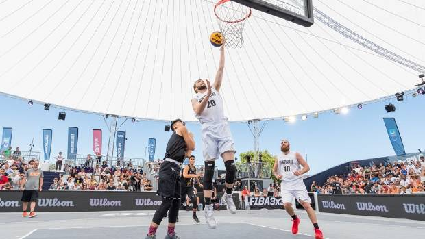 New Zealand basketballer Angus Riley heads for the basket on the opening day of the FIBA 3x3 World Cup tournament