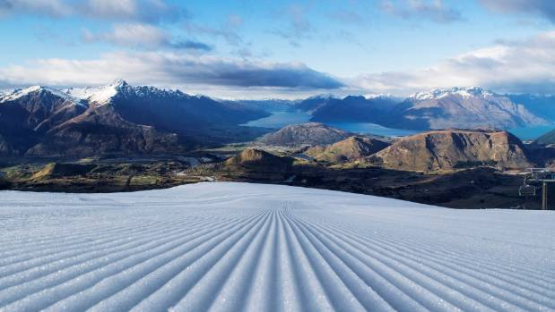 A freshly groomed Coronet Peak looking towards The Remarkables.