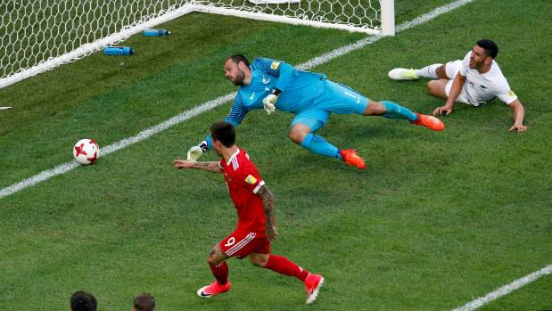 Boxall watches on in despair as Fedor Smolov doubles the home team's advantage past Kiwi goalkeeper Stefan Marinovic.