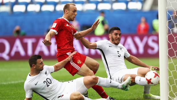 All Whites central defenders Michael Boxall, right, and Tommy Smith are unable to prevent Denis Glushakov's shot from ...