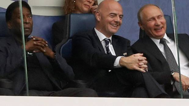 Russian president Vladimir Putin, right, enjoys the Confederations Cup opener with Fifa president Gianni Infantino, ...