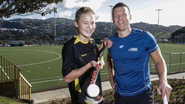 Black Sticks goal keeping legend Kyle Pontifex with age grade Wellington rep Ruby Baker, 13, during the opening of the ...