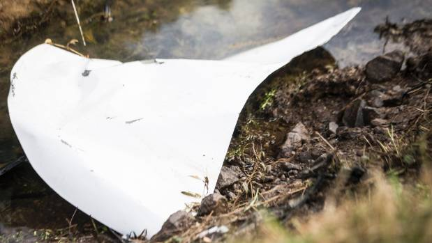 Debris left on the road after the quadruple fatal crash near Paeroa on Saturday evening.