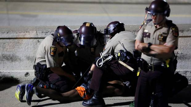 Minnesota police arrest a protester during a gathering this week following the acquittal of officer Jeronimo Yanez on a ...