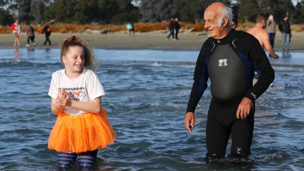 Sam Clarke, 11, and Greg Tulley, 85, had markedly different apparel choices in the mid-winter swim at Caroline Bay on Sunday.