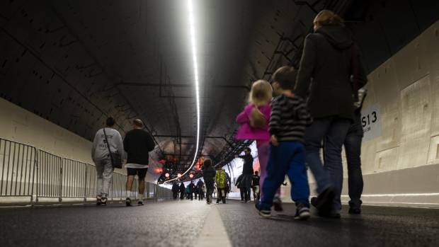 Tens of thousands of people walked through Auckland's new $1.4 billion Waterview Tunnel on Sunday.
