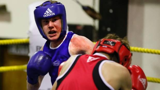 Zac Schofield, of Oamaru, fights James Charlton, of Rangiora, in the Timaru Boxing Club's annual tournament.