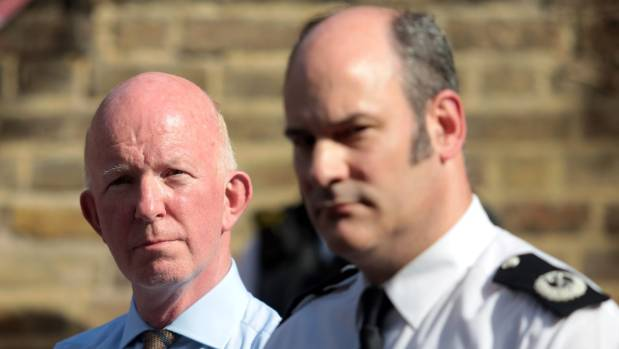 London Police Commander Stuart Cundy, right, says five people thought missing in the fire have been found safe and well.