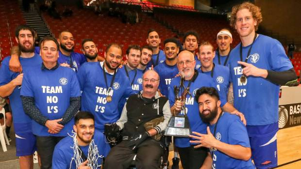 The Wellington Saints celebrate their 10th National Basketball League title with chairman Justin Toebes (centre).
