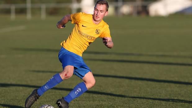 Queens Park striker Anton Fitzgerald controls the ball.