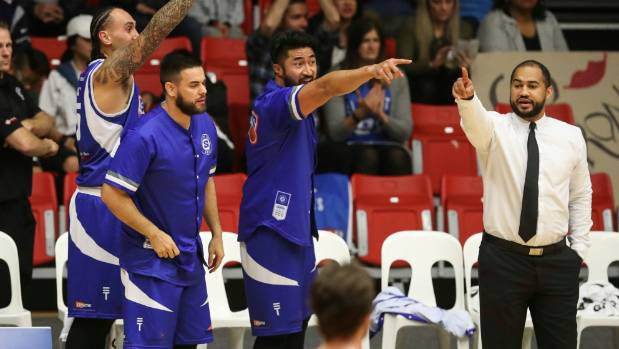 Wellington Saints coach Kevin Braswell, right, is all concentration during the NBL final on Saturday.