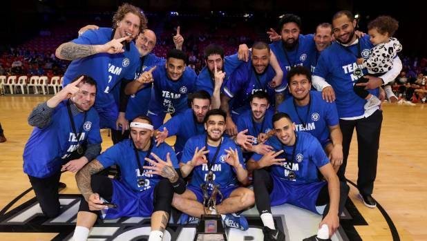 The Wellington Saints celebrate their National Basketball League win, completing the perfect season on Saturday night.