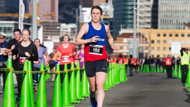In her third marathon, Alice Mason dominated the women's field and broke the race record by five seconds.