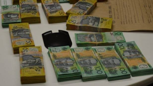 Police seized A$260,000 when they arrested Ping He and James Zhu as they left a Neutral Bay apartment in Sydney's north ...