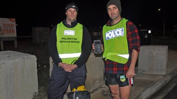 Constable Hamish McKnight and Constable Cam Ellis shortly after emerging from the Wainuiomata bush.