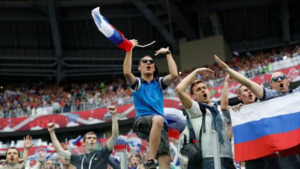 Russian fans celebrate their team's win over New Zealand in St Petersburg.