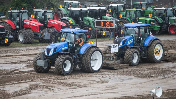 A tractor grinds to a halt after participating in the tractor pull.