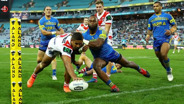 Dragons winger Nene MacDonald reaches out to score in a rare high point during their loss to the Eels.