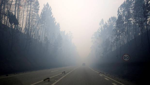 Smoke covers the IC8 motorway during the forest fire near Pedrogao Grande, in central Portugal.