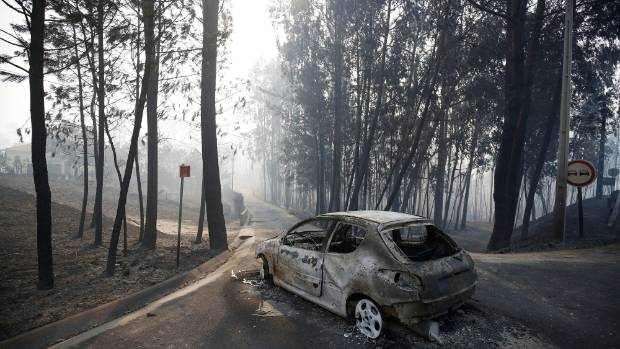 A burned car in the aftermath of the forest fire near Pedrogao Grande, in central Portugal.
