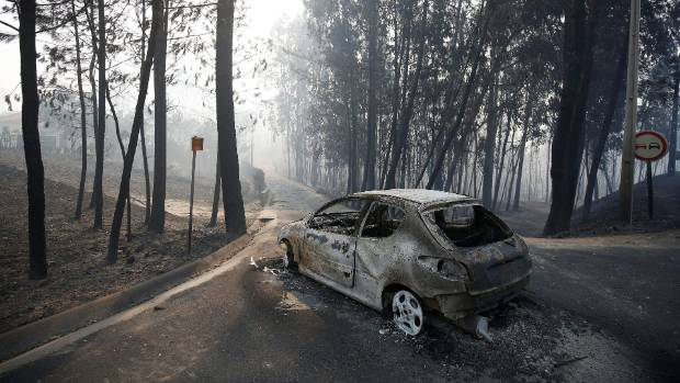 A car is left burnt-out following the deadly fires.