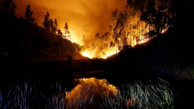 The blaze lights up the sky near Bouca, in central Portugal.