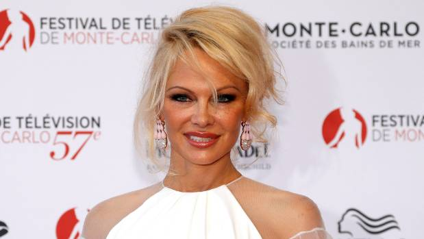 """Actress Pamela Anderson signed the letter with her love for """"sexy"""" WikiLeaks founder Julian Assange."""