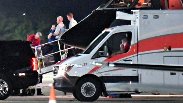 A person believed to be Otto Warmbier is transferred from a medical transport airplane after he was brought home from ...